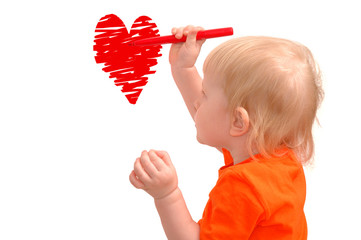 Small child draws red heart
