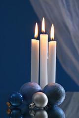 christmas balls and burning candles