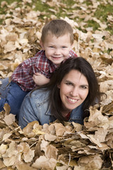 Boy and mom in leaves