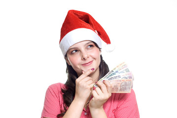 Pretty girl wearing Santa hat holding indian rupees