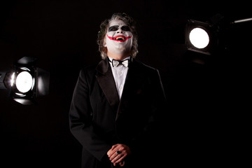 smiling man in an image of a joker