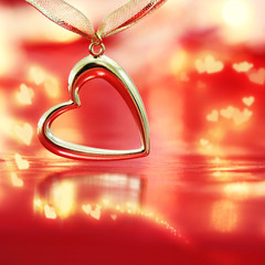 Golden heart on blazing red background