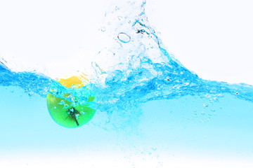 Green apple under water splashing