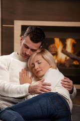 Couple hugging home