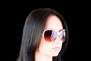 Young girl with sunglasses isolated on black