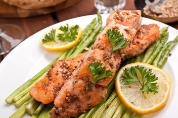 healthy salmon with coriander garnished with asparagus