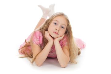 Beautiful girl lying on floor isolated studio shot