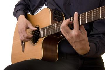 man plays acoustic guitar