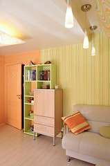 Room in the house. Vertical. Orange and yellow colors.