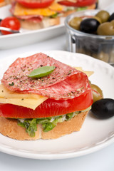 sandwich with salami ,cheese and vegetables