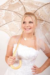 Young sexy bride with umbrella under the rain
