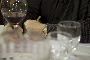 Businessman holding a glass of wine