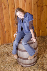 Woman on barrel with toes pointed together