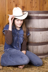 Woman tipping hat by barrel