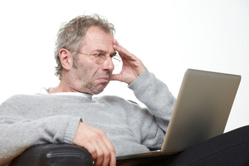 contenplative man working with his laptop