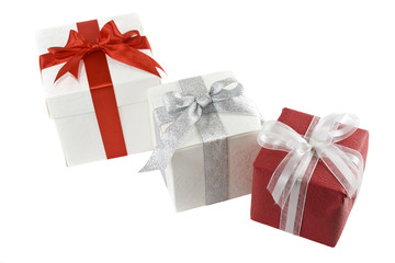 three gift boxes isolated over white