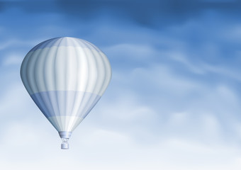 White hot air balloon in the blue sky