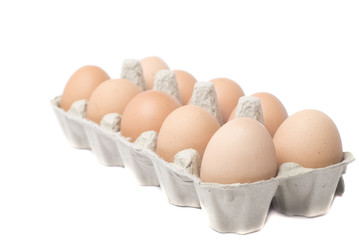 eggs in packing on white background