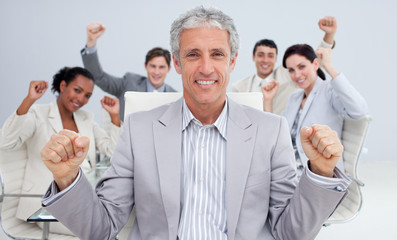 Happy businessman celebrating a sucess with his team