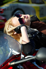 The blonde in points on a motorcycle