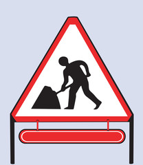 Road sign showing man at work