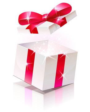 Ouverture d'un cadeau au ruban rouge (reflet)