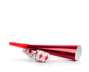 Red and silver noise makers on white