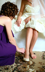 she helps a young bride, dresses her