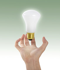 Holding a light bulb.