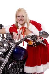 santa helper leaning on motorcycle