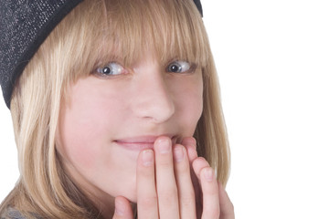Laughing teenage girl covering her mouth with her hands