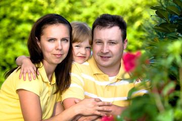 a closeup summer portrait of a happy family