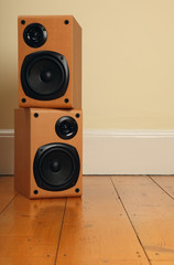 Stacked Speakers on Wooden Floor