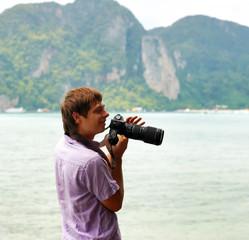 Funny photographer on the beach
