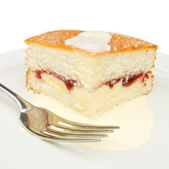 Slice of cake and cream with a fork