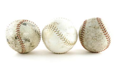 3 Worn softballs lined up