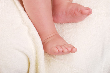 Children's legs on a soft towel