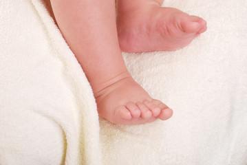 Children's legs on a soft towel