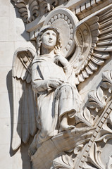 Angel Sculpture with Wings and Holy Bible