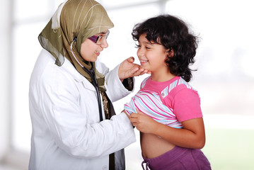 Young muslim doctor in his office