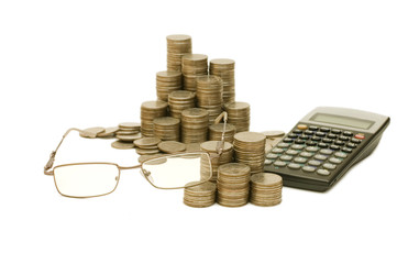 Coins and the calculator isolated on white