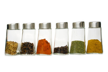 Six jars of spices isolated over white