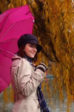 Beautiful young girl under umbrella