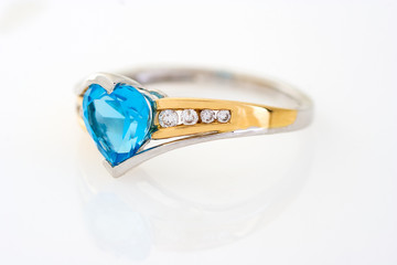 gold diamonds ring with blue sapphire heart shaped