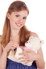 smiling girl with teddy bear in hands