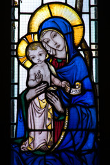Stained glass window with mother and child