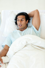 Male patient lying in a hospital bed