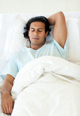 Male patient sleeping in a hospital bed