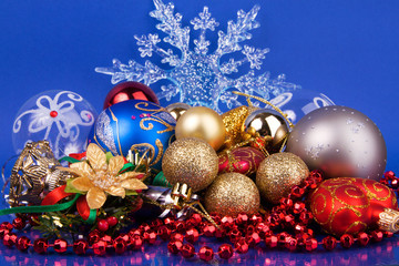 Christmas toys on blue background with snowflake