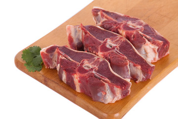 Fresh mutton on wooden board with parsley
